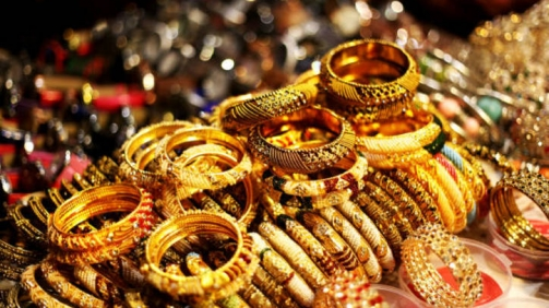 Bracelets and bangles in a row in street market.